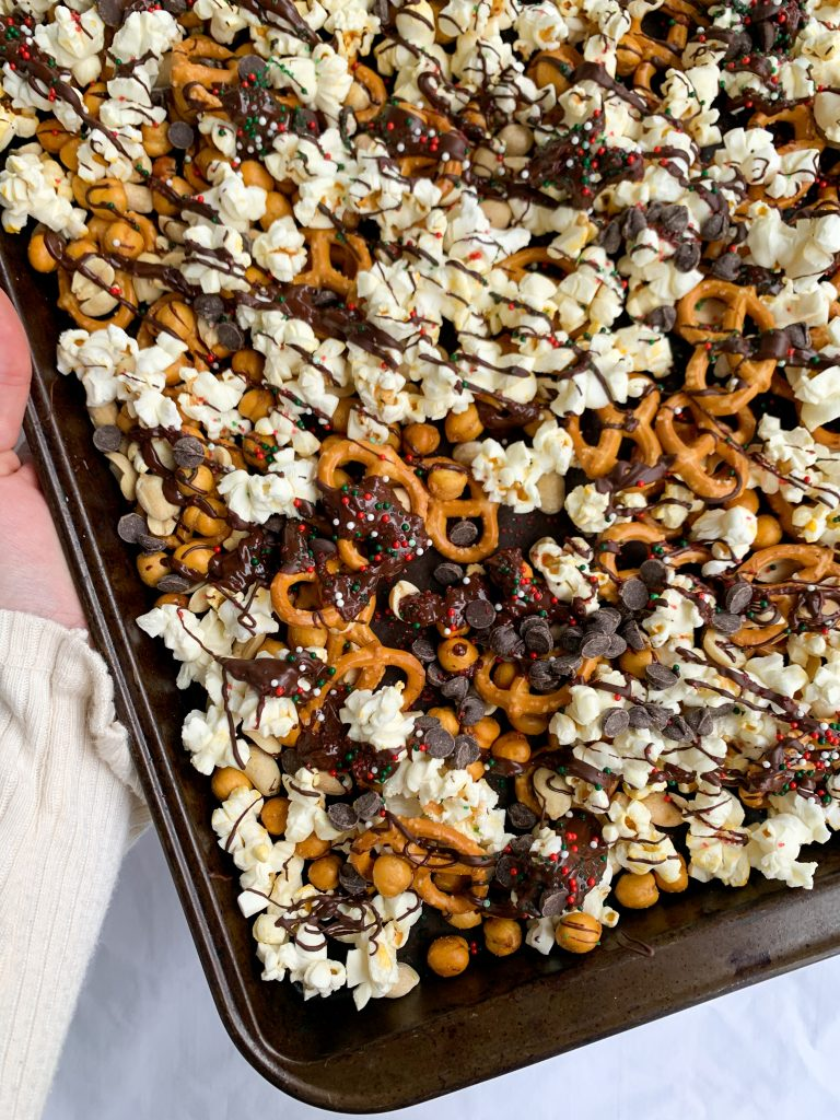 a baking tray with the sweet & salty christmas snack mix