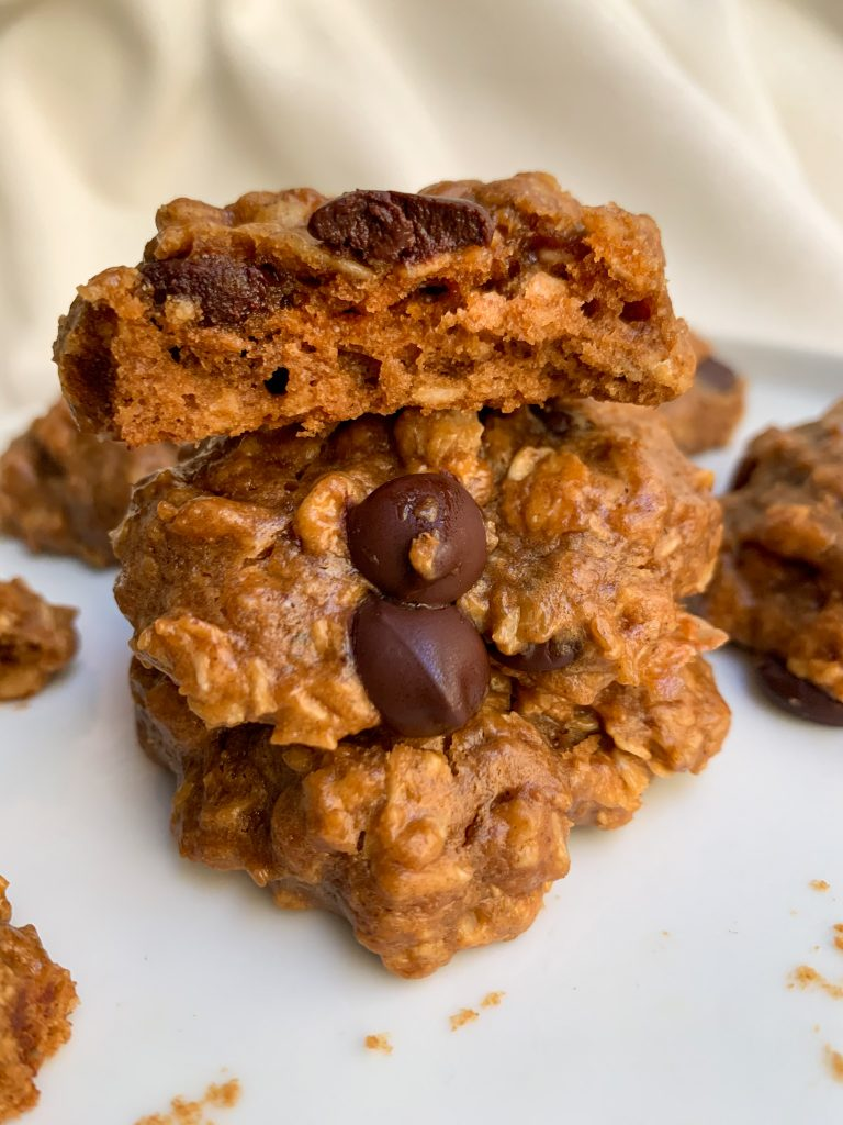 a stack of Peanut Butter Chocolate Chip Oatmeal Cookies on a white plate