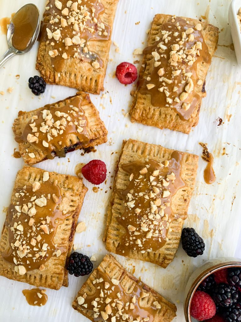 a platter of the peanut butter and jelly pop tarts with berries