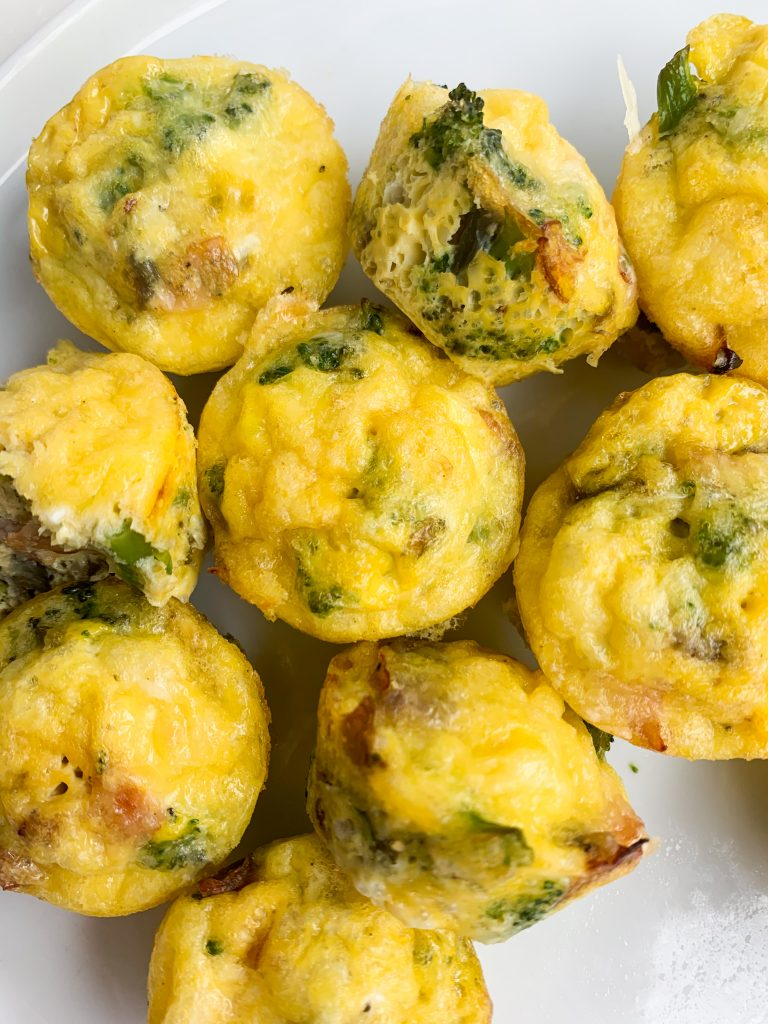 ham, swiss, and broccoli egg bites on a white plate
