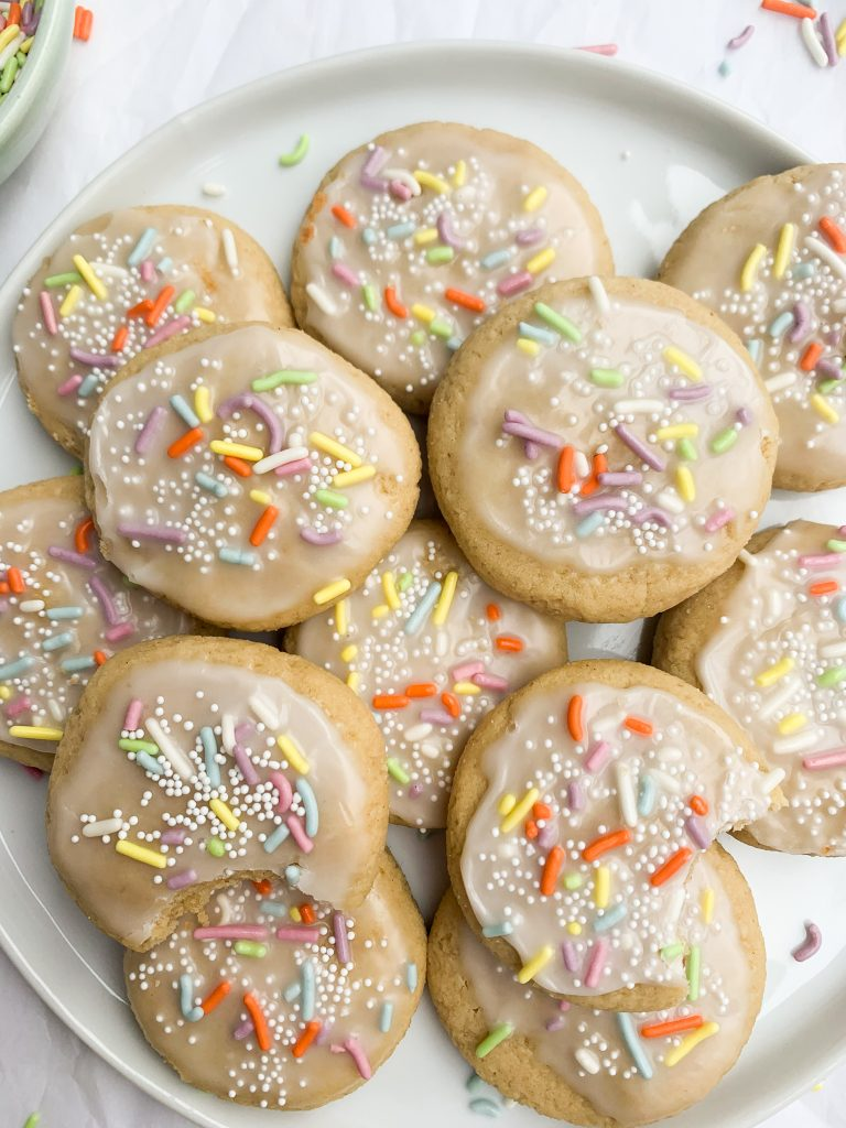 a white plate of gluten free sugar cookies