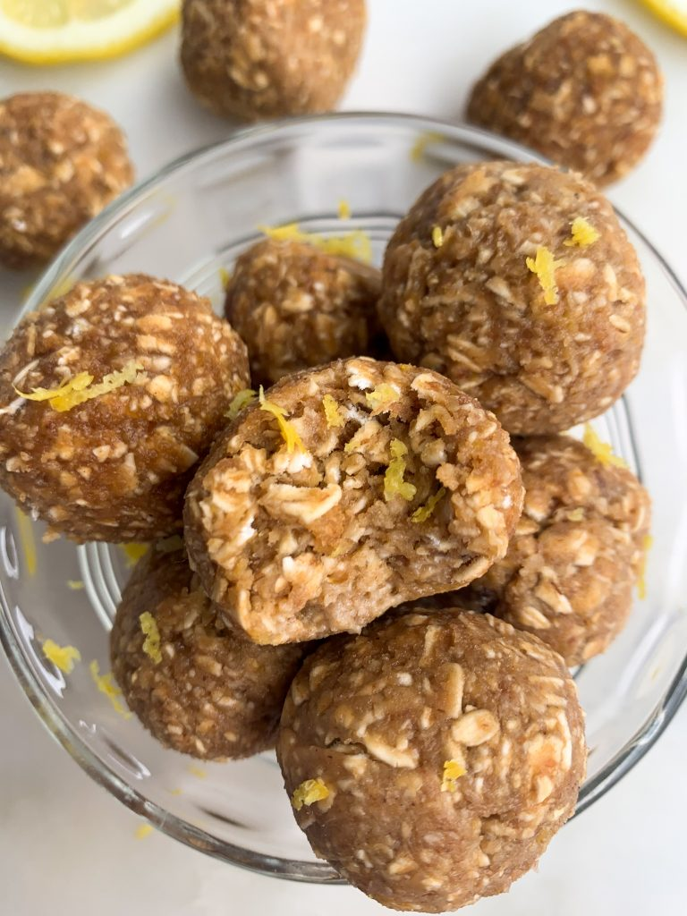 lemon oatmeal energy balls in a glass bowl over a white background