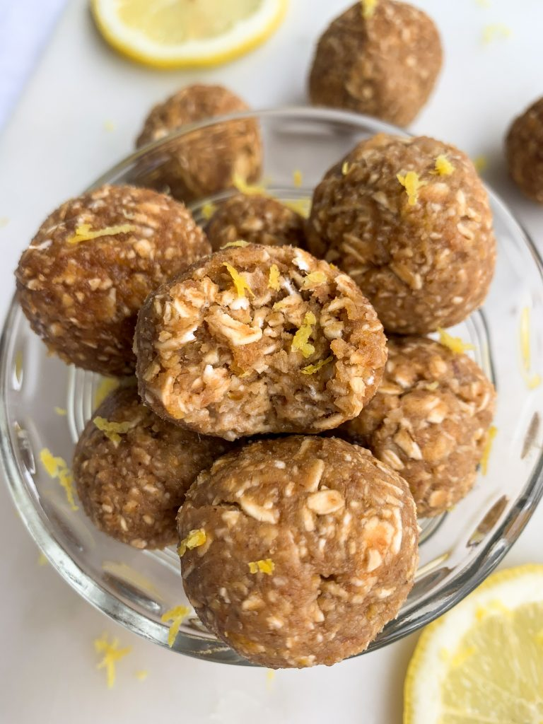 lemon energy oatmeal balls in a white bowl over a white background