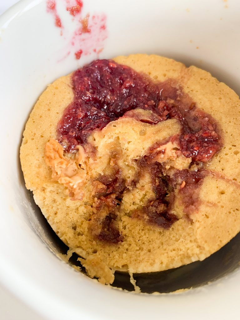 the mug cake with a bite taken out