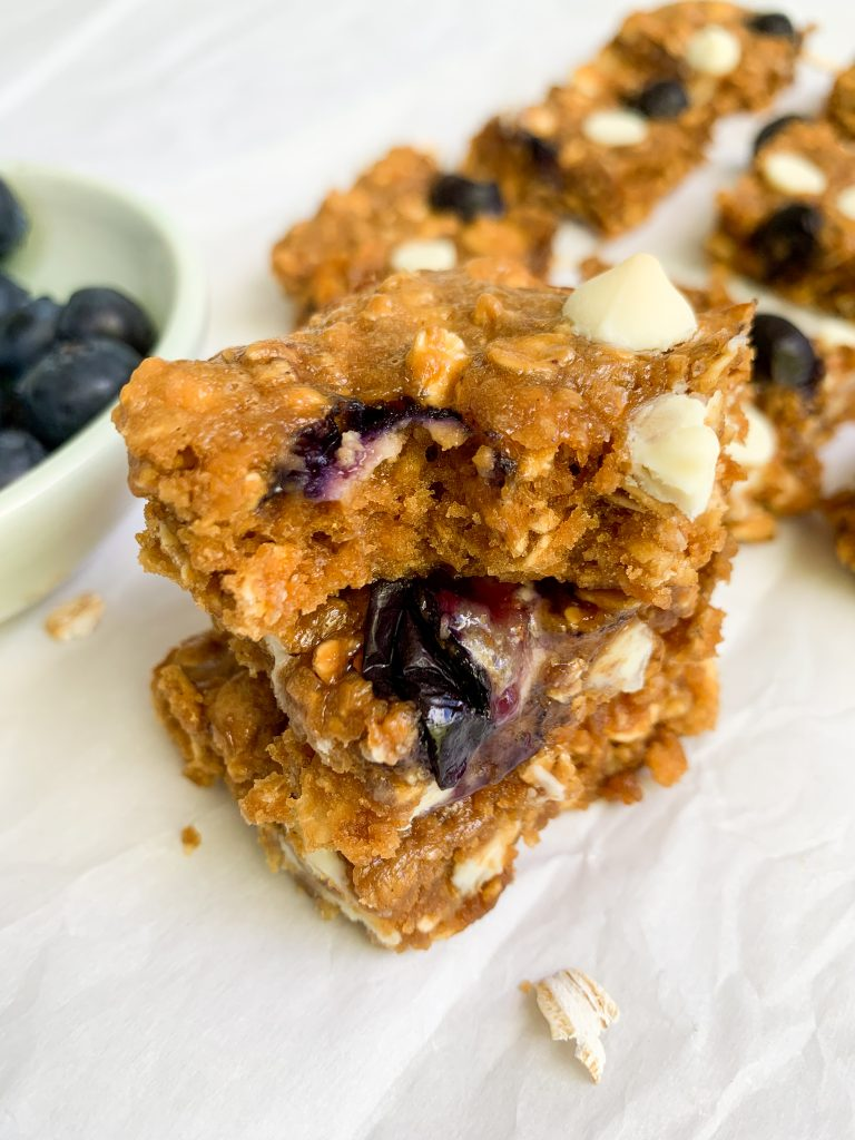 a stack of white chocolate & blueberry oatmeal cookie bars