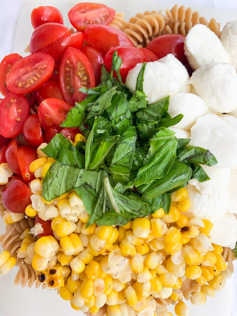 tomato, basil, corn, mozzarella, and pasta