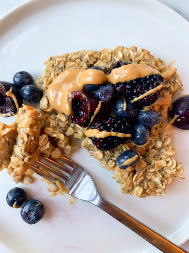baked oats topped with peanut butter and fresh fruit