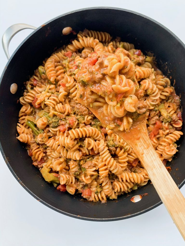 spoonful of pasta over the pot of the pasta