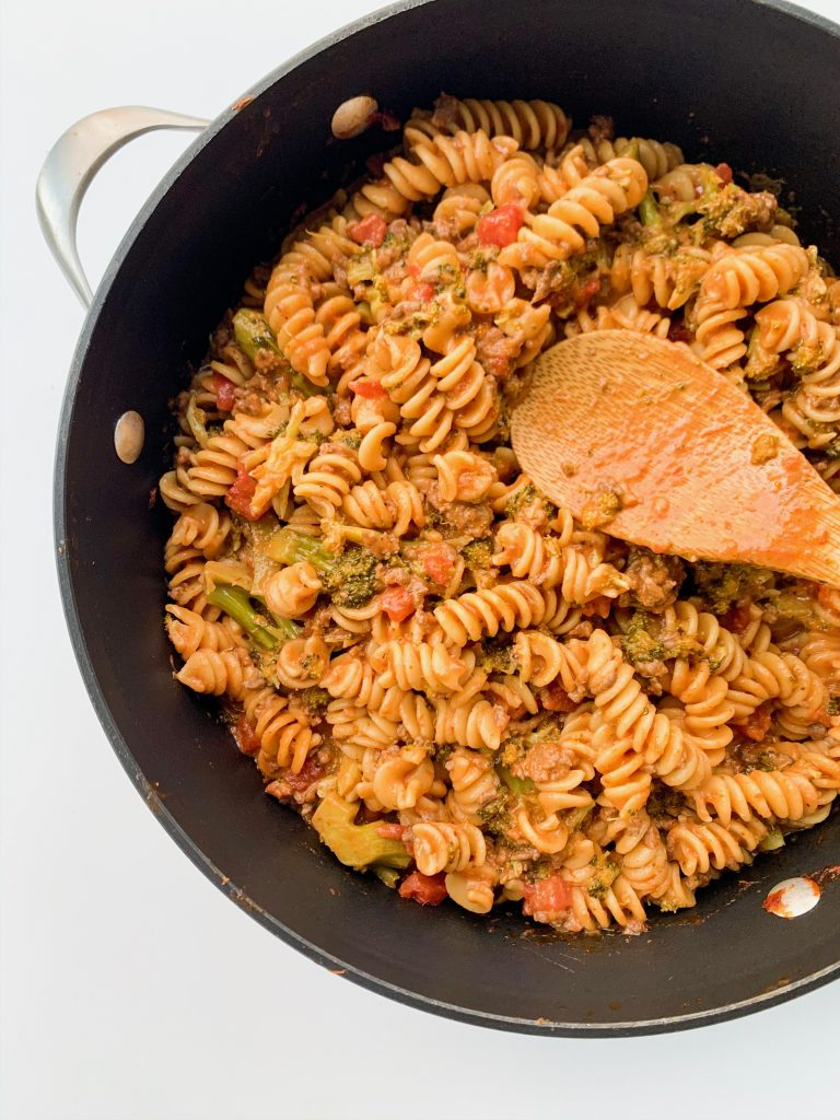 family favorite one pot pasta with a wooden spoon