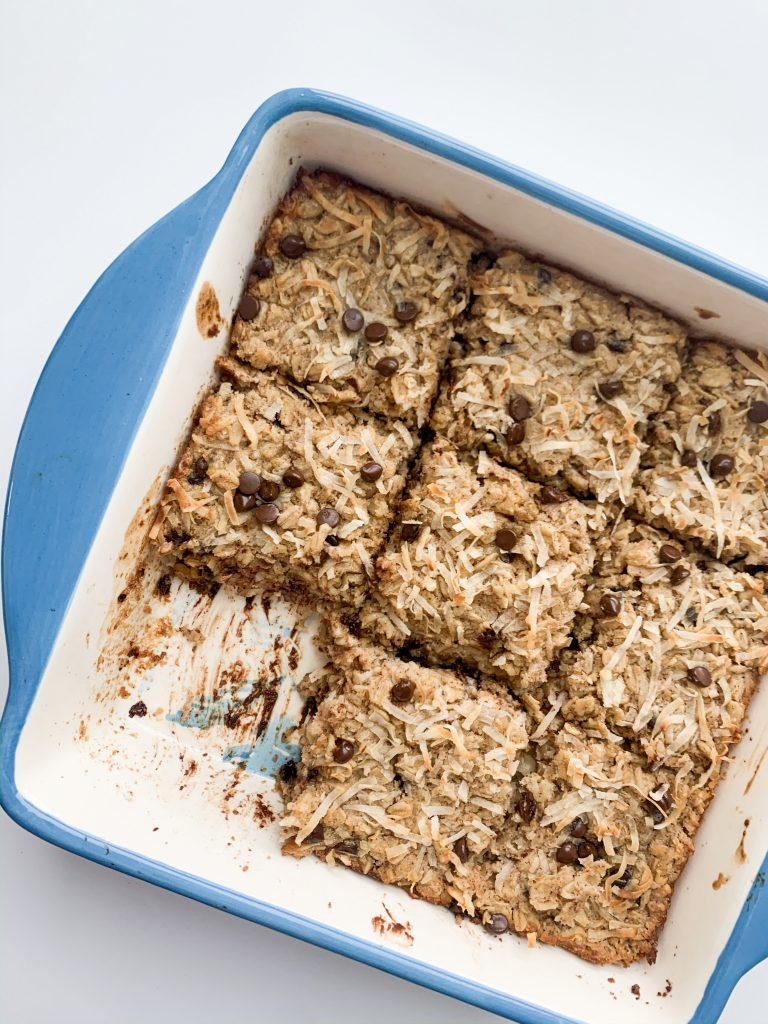baked oatmeal in a blue baking dish with one square taken out
