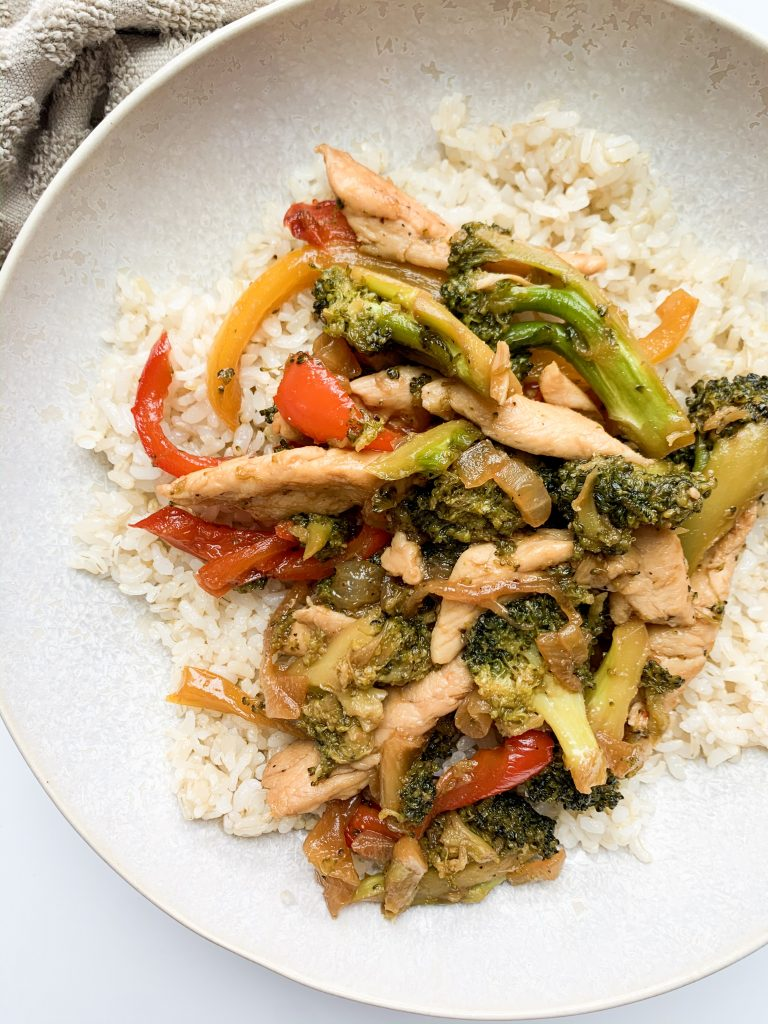 chicken, vegetables, and rice in a bowl