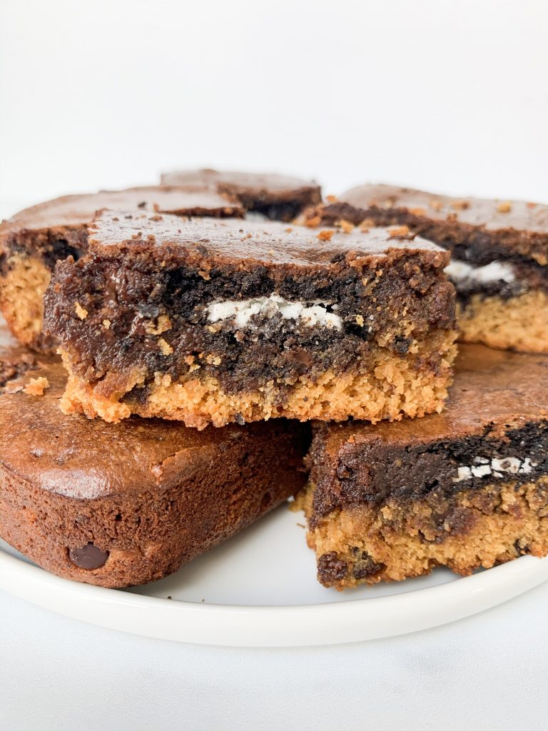 a white plate of gluten free slutty brownies