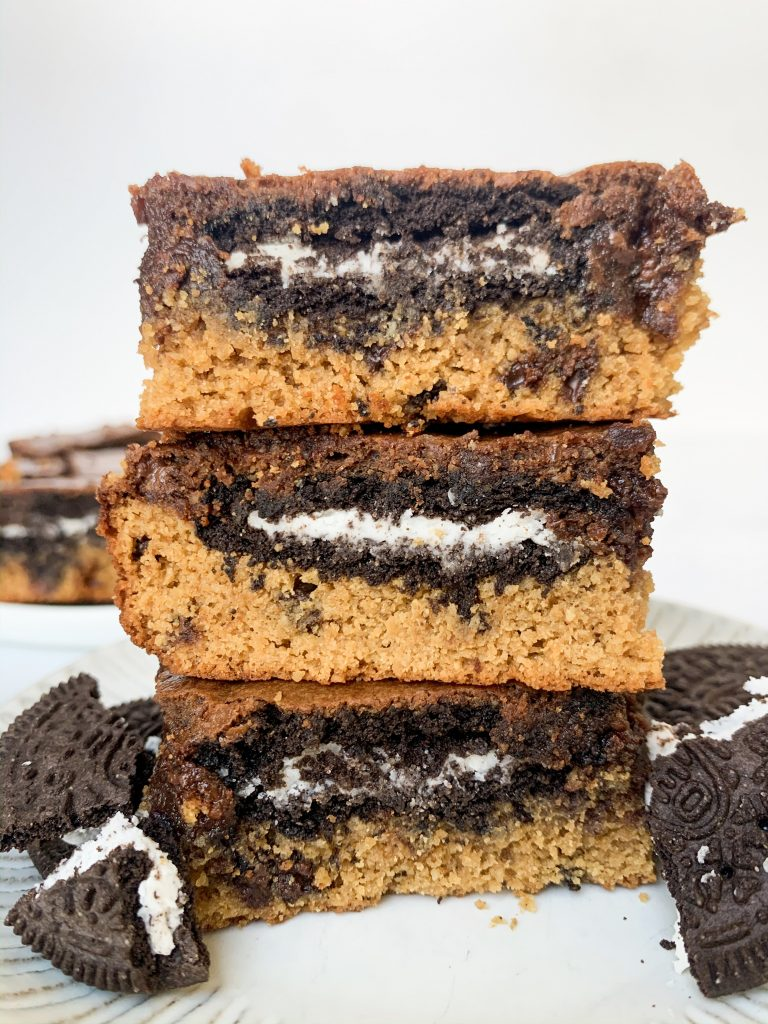 a stack of gluten free slutty brownies on a small plate