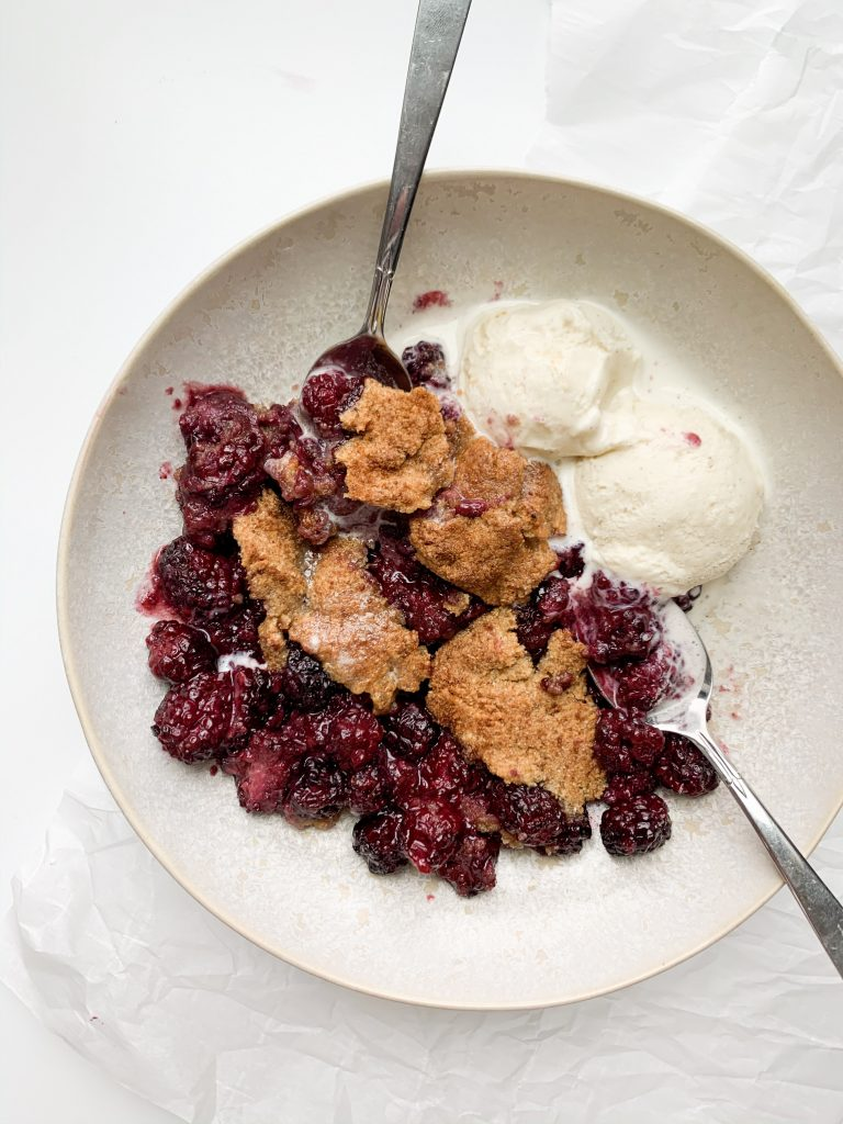 healthy blackberry cobbler in a bowl with ice cream