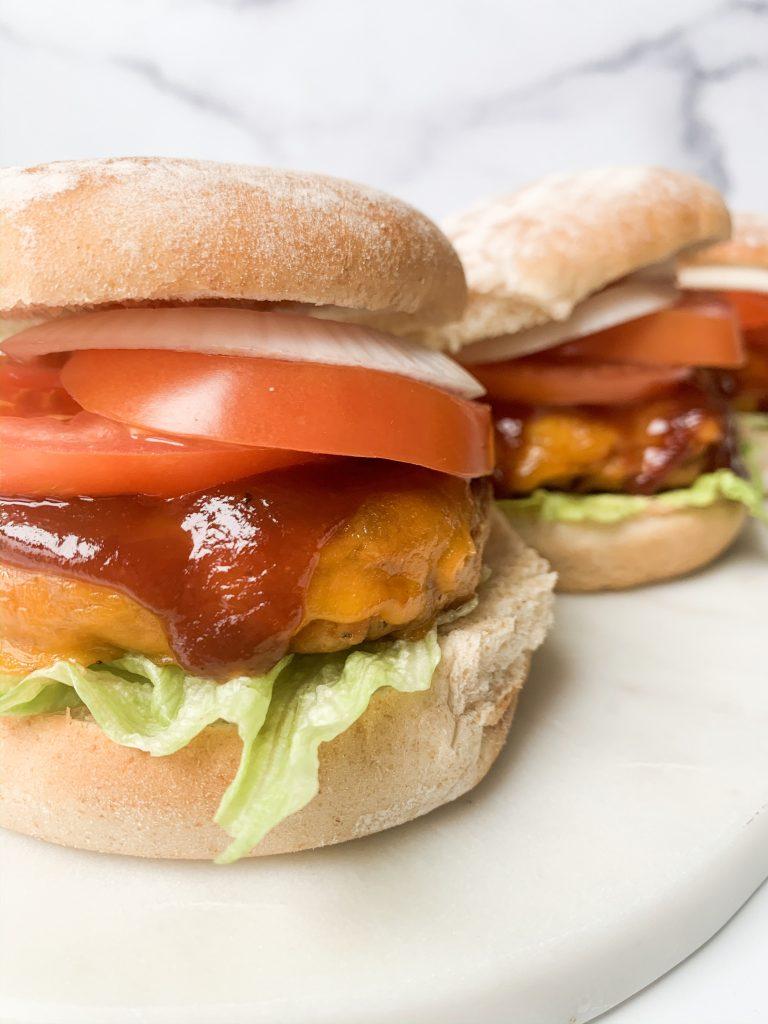 three burgers on a platter