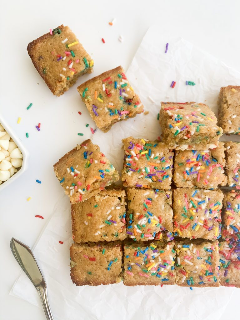 blondies, sprinkles, and white chocolate chips on a white background
