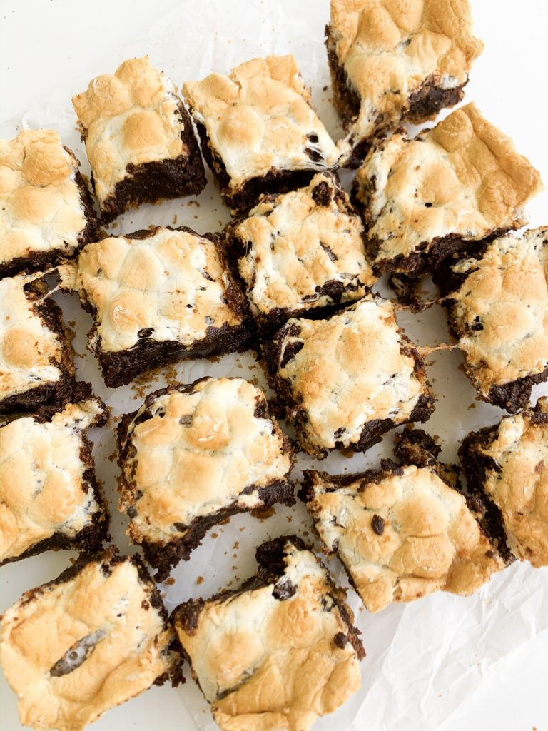brownies with marshmallows on top on a white background