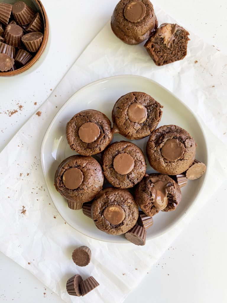 a plate of peanut butter brownie bites on a white background