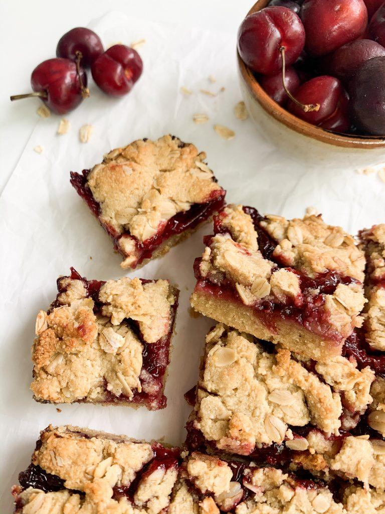 cherry bars and a bowl of cherries on a white background
