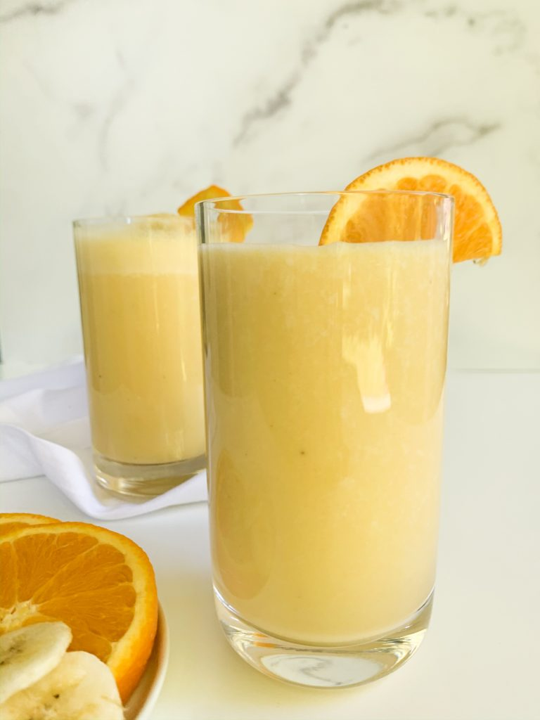 two glasses of orange creamsicle smoothie