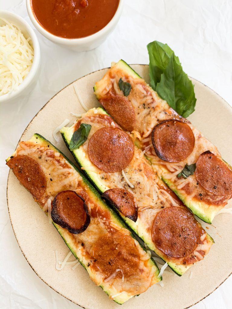 baked zucchini boats with a side of mozzarella cheese & marinara sauce