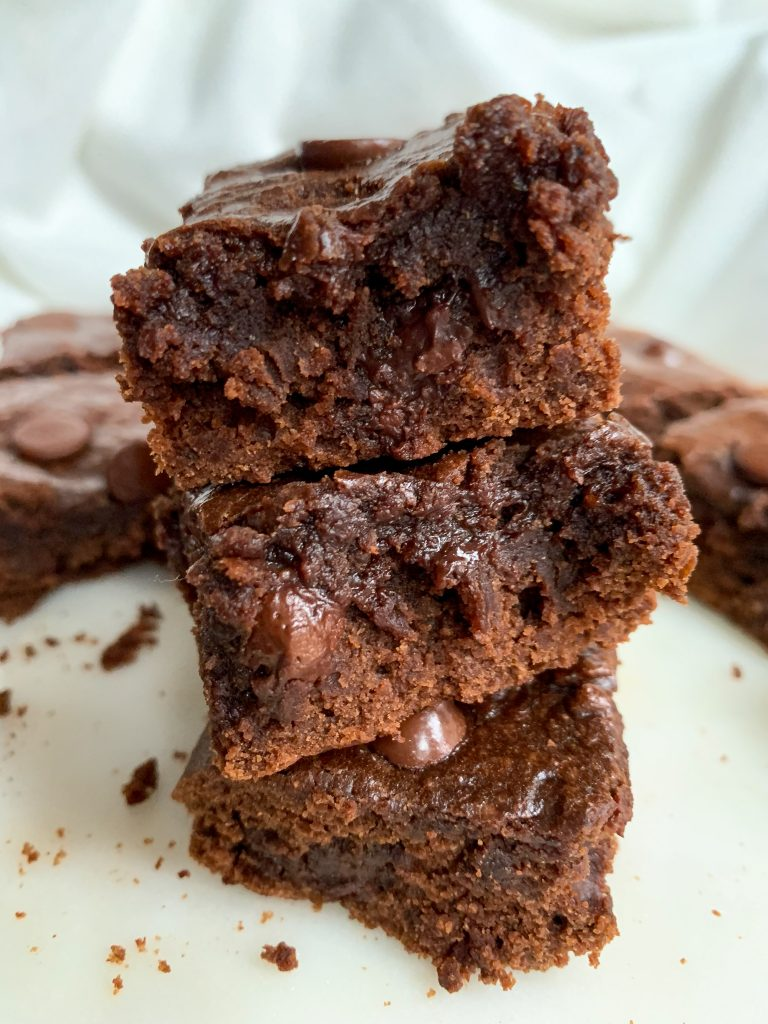 a stack of healthy fudgy brownies on a white plate
