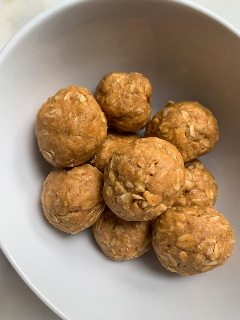5 ingredient protein bites in a white bowl on a white board